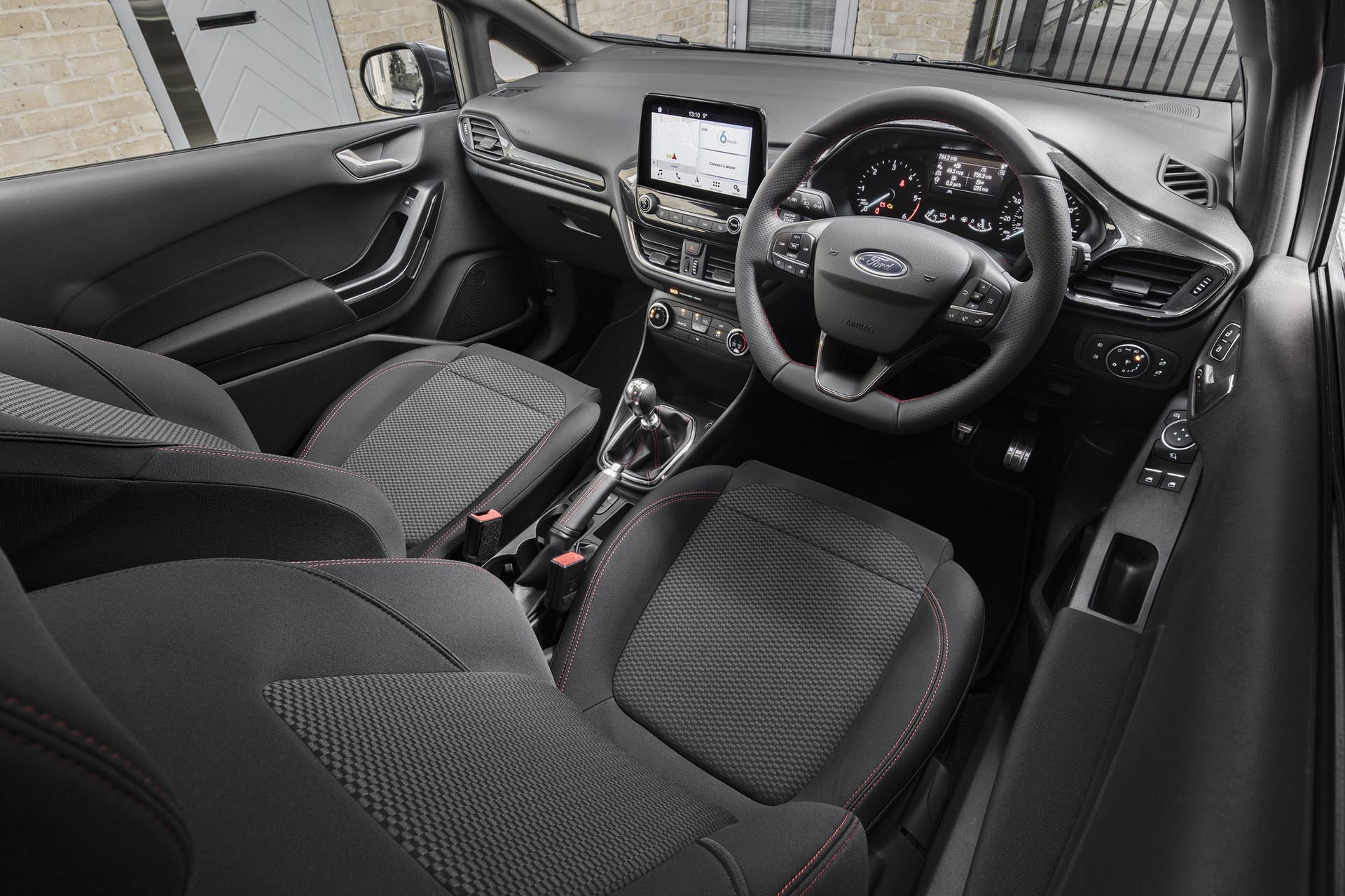 The Fiesta Van EcoBoost Hybrids interior is well suited to modern commercial use